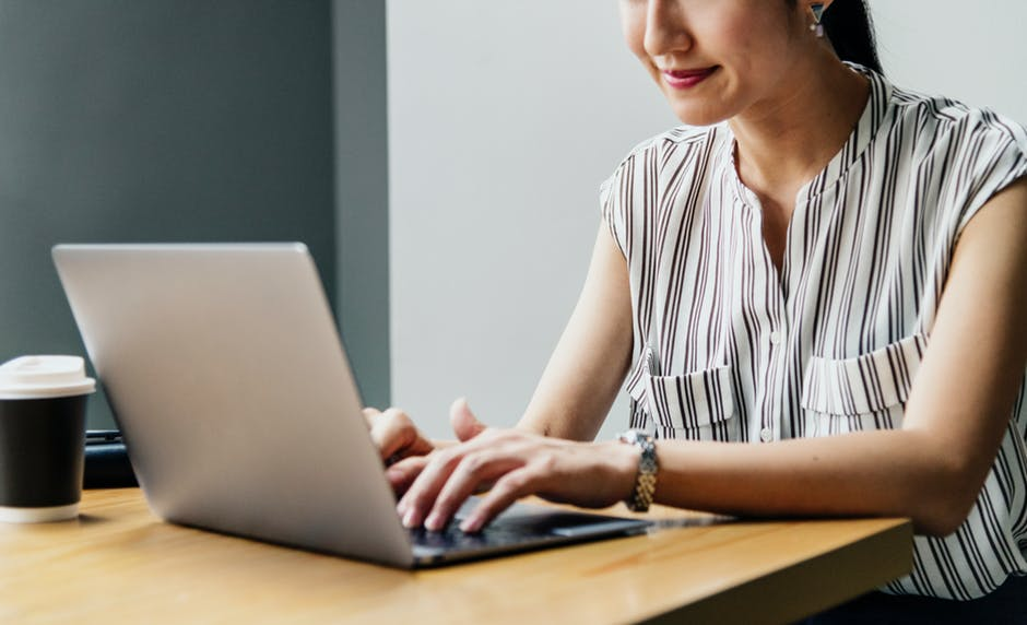 Woman using a laptop to work