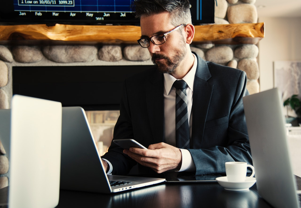 man reading about corporate secretary duties