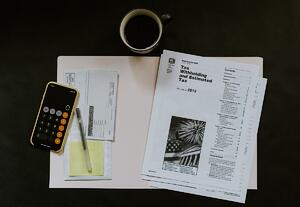 Use tax code to deduct taxes under PAYE