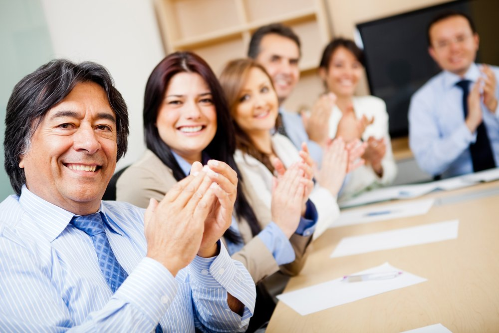 Successful business team in a meeting applauding